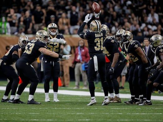 New Orleans Saints safety Chris Banjo celebrates with