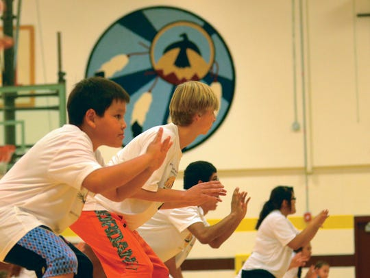 Campers practice their defensive stances at Michael