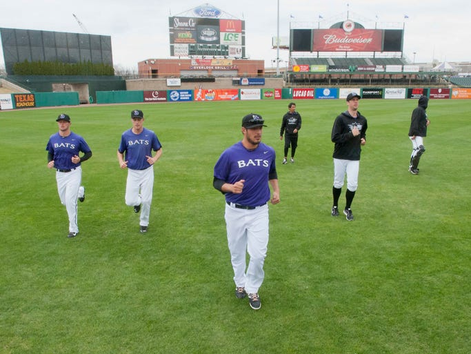 Louisville Bats pitcher Pedro Villarreal, center, leads his teammates in a jogging warm-up at the Bats' baseball practice at Slugger Field. 02 April 2013