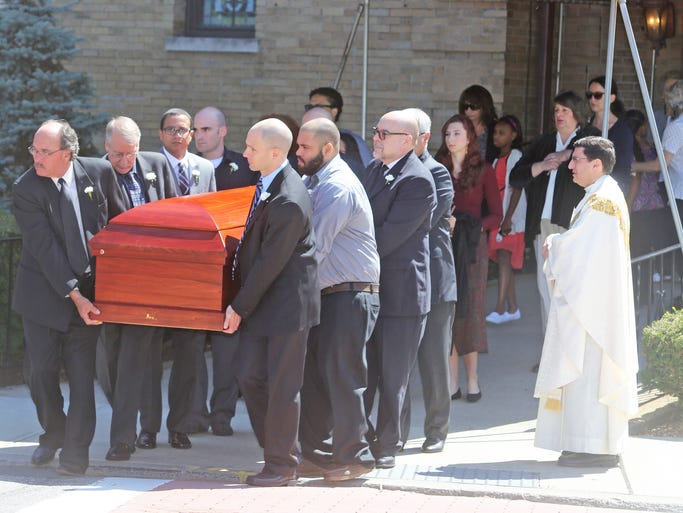 Pall bearers carry the casket of James DeVito from Sacred Heart Church in Suffern after a funeral for the Airmont man Aug. 19, 2014. DeVito was killed on Aug. 12th when Richard Christopher, an off duty New York City police officer, drove his car the wrong way on the New York State Thruway in Ramapo and struck DeVito's car.