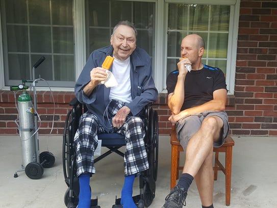 Tony and Jerry Jacob enjoy some Popsicles.