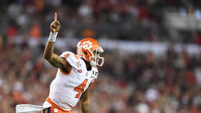 Clemson quarterback Deshaun Watson (4) reacts after running back Wayne Gallman (9) scored on a 1 yard dive against Alabama during the 4th quarter of the National Championship at Raymond James Stadium in Tampa on Monday, January 9, 2017.