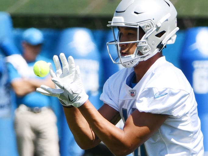 Wide receiver TJ Jones works on his hand coordination