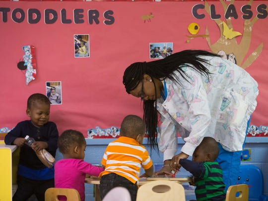 Teacher Deanita Thomas works with the toddler one kids, Jer'Vah Charles (from left), Jordan Archie, Sa-Maj Wright, and Nazeef Jackson at West Center City Early Learning Center at 600 N. Madison Street in Wilmington before their nap time.