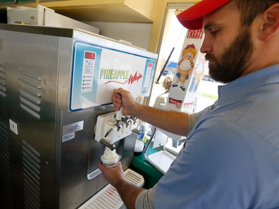 Zach Fortner pours a Pineapple Whip during their first
