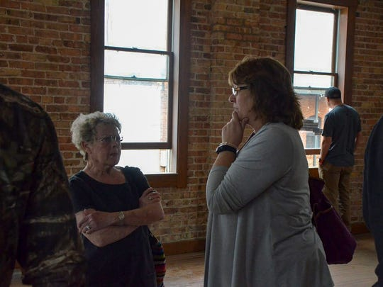 Connie Becker (left) and Beverly Eberhard mingle at the 15 Carlyle open house during Spring into the Arts 2018.