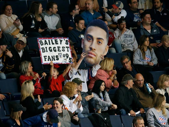 Amerks' fans hold Justin Bailey signs during the game