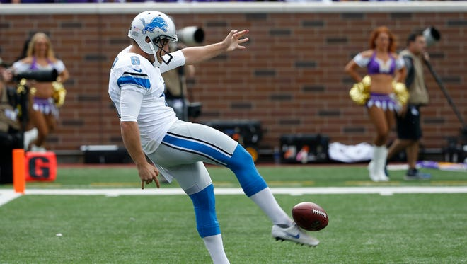 Detroit Lions punter Sam Martin punts against the Minnesota Vikings on Sept. 20, 2015.