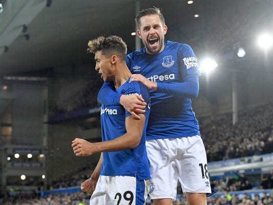 Everton's Dominic Calvert-Lewin, left, celebrates scoring his side's second goal with team-mate Gylfi Sigurdsson during the English Premier League soccer match between Everton F.C and Huddersfield Town at Goodison Park,Liverpool, England. Saturday. Dec. 2, 2017. (Dave Howarth/PA via AP)