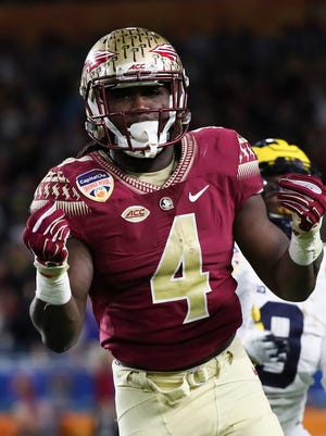 Dalvin Cook celebrates after a catch in the first quarter.