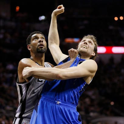 San Antonio Spurs power forward Tim Duncan (L) and