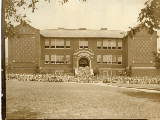 Students gathered in front of the Smyth School in a photo taken sometime between 1935 and 1948.