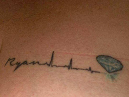 Kim Winger chose this tattoo, which uses the actual heartbeat readout from the final moments of her son, Ryan Shwonek's, life. Ryan's organs were donated to several recipients.