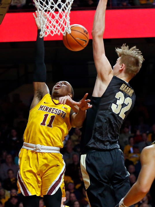 Minnesota's Isaiah Washington, left, is fouled by Purdue's Matt Haarms, of The Netherlands, in the second half of an NCAA college basketball game Saturday, Jan. 13, 2018, in Minneapolis. Purdue won 81-47. (AP Photo/Jim Mone)