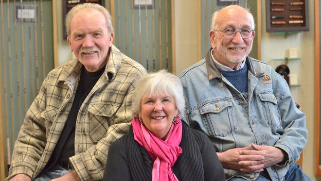 From left, Mike Vincent, 69, of Butte; Christine Lambert, 70, of Butte; and Andy Hupe, 81, of Sheridan pose at Sweetgrass Rods in Twin Bridges on Dec. 21.