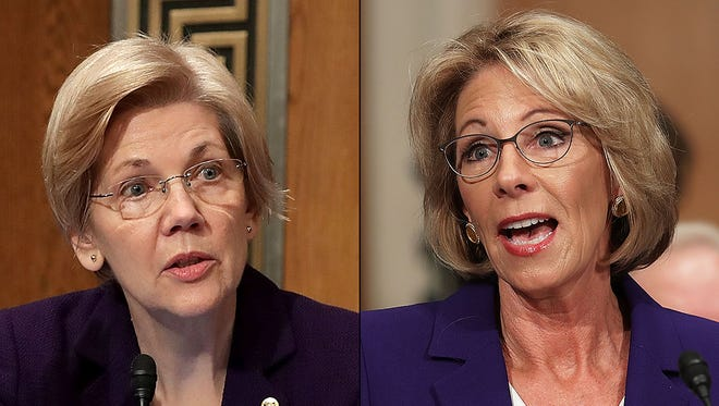 Sen. Elizabeth Warren, D-Mass., and Betsy DeVos during DeVos' confirmation hearing for Secretary of Education on Jan. 17, 2016.