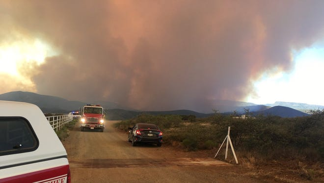 "At the time of this photo on June 27, 2017, firefighter crews were battling windy conditions at the Goodwin Fire in Prescott. By the morning of June 28, 2017, the fire had spread to 20,644 acres. Governor Doug Ducey called it the state's ""top priority."""