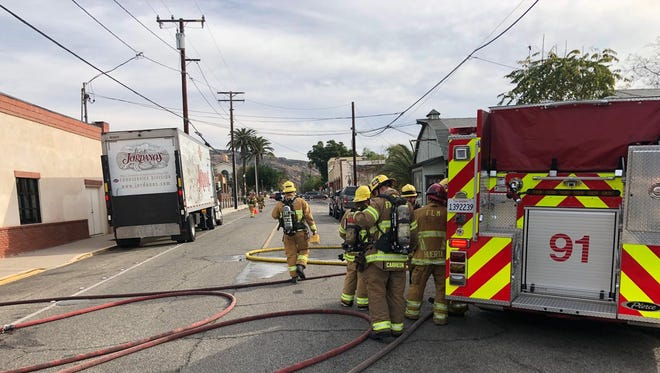 Fire crews respond to a crash on Santa Clara Street in Fillmore Wednesday morning. The vehicle struck a gas main, and the incident closed a portion of the road for nearly two hours.