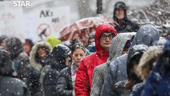 Participants line up in the snow outside the Indiana Statehouse to take part in a March for Our Lives rally on Saturday, March 24, 2018.