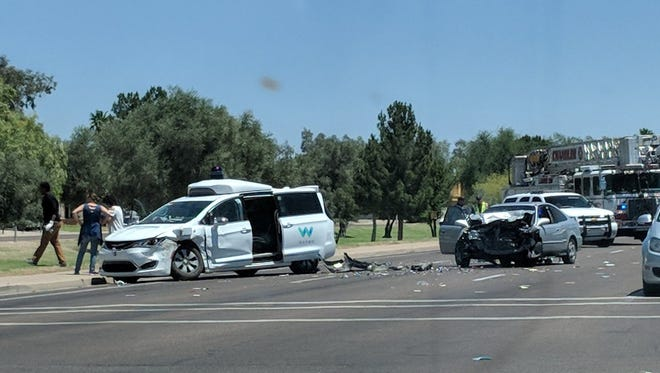 A Honda sedan swerving to avoid another car crashed into a Waymo self-driving van on May 4, 2018 in Chandler, Ariz. The can's driver was injured.