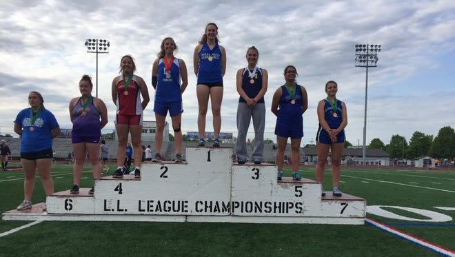 Cedar Crest's Hannah Woelfling reached the top of the medal stand on Friday at the Lancaster-Lebanon League Track and Field Championships after winning gold in the discus.