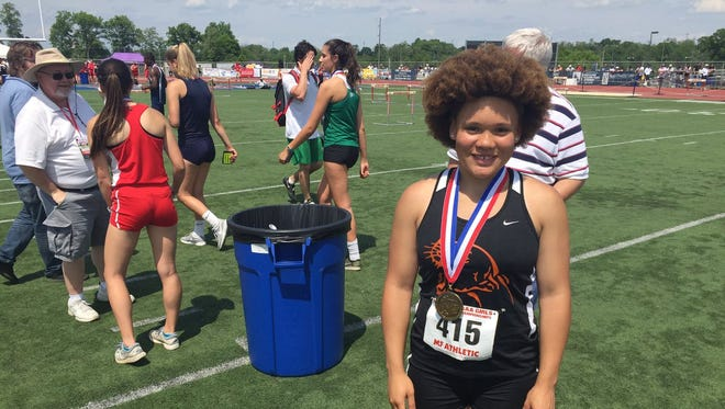 Palmyra's Kirstin West poses with the third place medal she captured in the AAA Girls Javelin on Saturday at the PIAA Track and Field Championships.