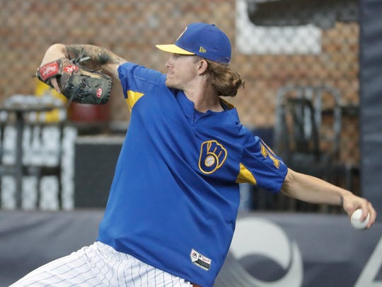 Brewers relief pitcher Josh Hader warms up before a