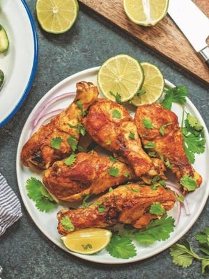 """These Indian-spiced chicken drumsticks are from """"Slow Cooked Paleo"""" by Bailey Fischer."""