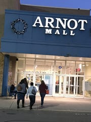 Shoppers enter the Arnot Mall in Big Flats early Friday
