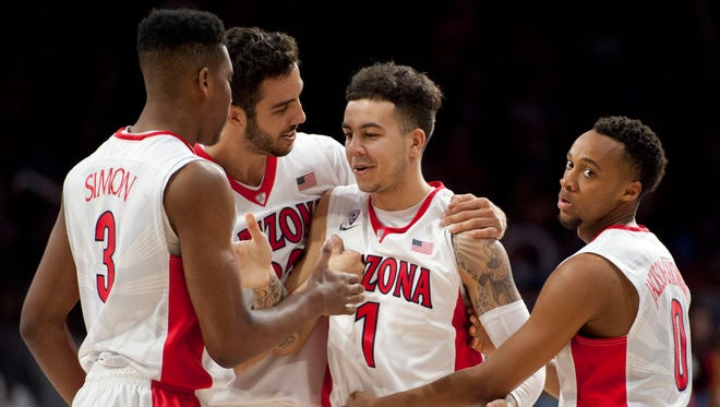 Dec 13, 2015: Arizona Wildcats guard Gabe York (1) is congratulated by guard Justin Simon (3) and forward Mark Tollefsen (23) and guard Parker Jackson-Cartwright (0) after drawing a foul during the second half against the Missouri Tigers at McKale Center. Arizona won 88-52.