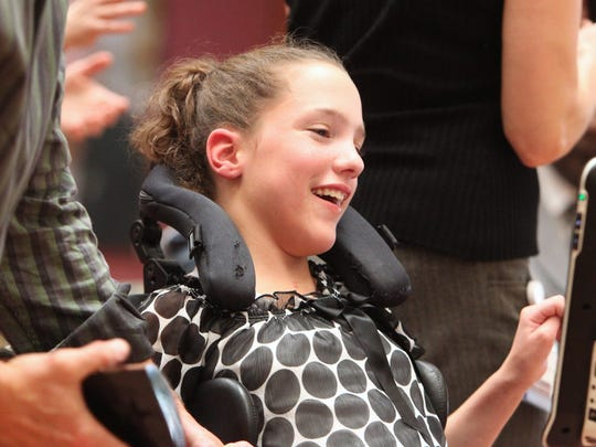 Tara Lynch receives a team treatment award at the Helen Hayes Hospital Honors Assembly in West Havestraw Sept. 16, 2014.