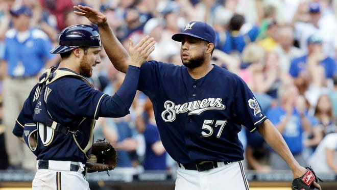Milwaukee Brewers catcher Jonathan Lucroy and Francisco Rodriguez (57) celebrate a win over the Pittsburgh Pirates on Aug. 24, 2014, in Milwaukee.