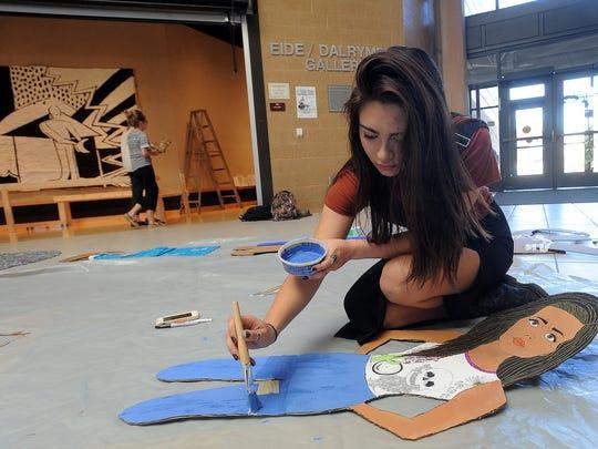 Brandon Valley High School senior Bailey Bernal paints