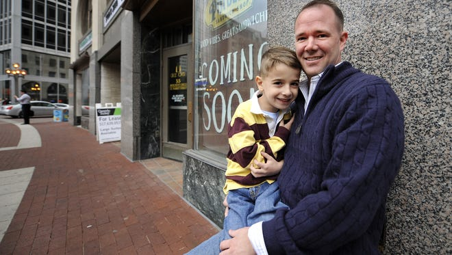 Chuck Brewer, with his son Charlie on Monument Circle in 2011.