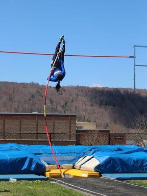 Lansing pole vaulter Miya Kuramoto goes up and over the bar at a recent meet in Moravia.