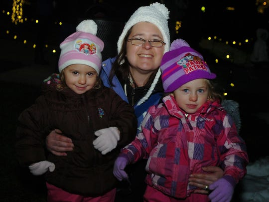 Lisa Tope of Birmingham enjoys the festivities with her twin daughters, Rose and Paige.