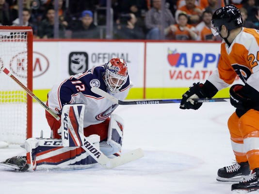 Philadelphia Flyers' Matt Read, right, cannot get a shot past Columbus Blue Jackets' Sergei Bobrovsky during the second period of an NHL hockey game, Thursday, March 15, 2018, in Philadelphia. (AP Photo/Matt Slocum)