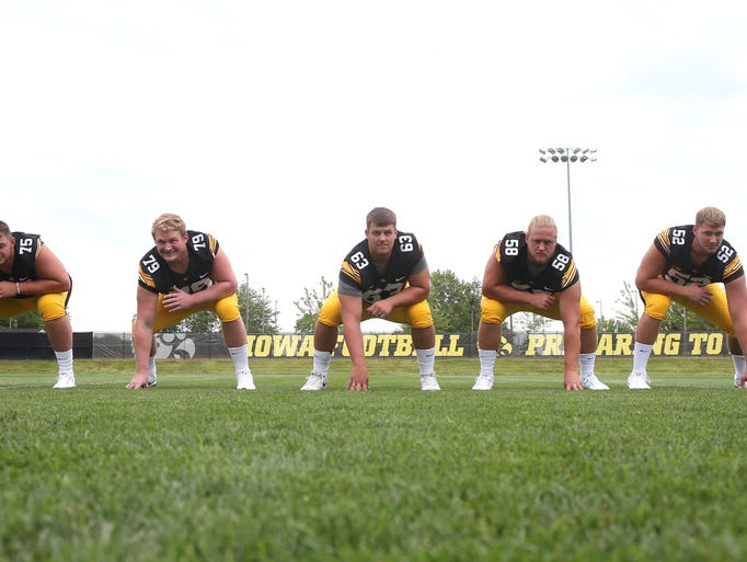 Members of the Iowa offensive line, from left, Ike