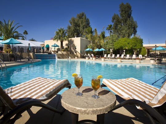 Scottsdale Plaza Resort The Scottsdale Plaza Resort has a spa-party package for you and three of your best friends. Relax by the pool at Scottsdale Plaza Resort.