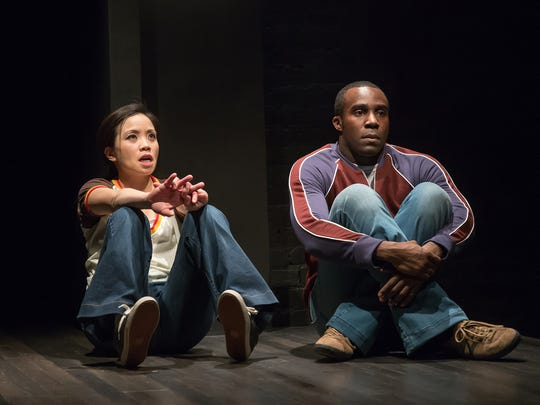 """Tina Chilip (L) and Tramell Tillman in a particularly touching scene in the Playhouse in the Park's world premiere production of Jen Silverman's """"All the Roads Home."""" The show runs through April 23."""