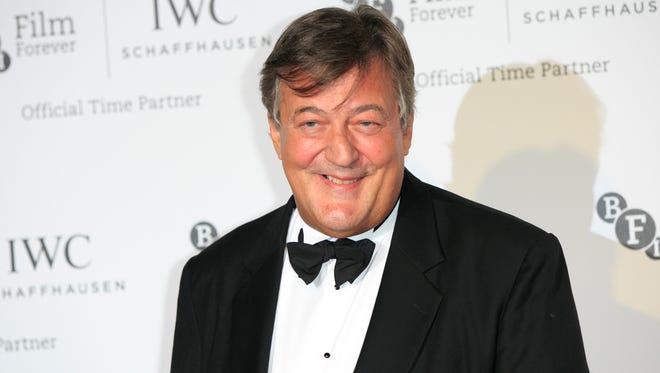 """Stephen Fry poses for photographers upon arrival at the British Film Institute London Film Festival Gala Dinner in central London on Oct. 7, 2014. Actor-comedian Stephen Fry says he is getting married _ and is """"very, very happy"""" even though his hopes of a private wedding have been dashed."""