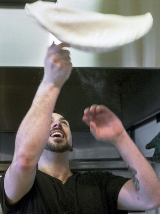 Disma Ferrante tosses pizza dough while making a pizza at Slice of Italy, 476 E. Main Street in Dallastown Sunday June 28, 2015. Paul Kuehnel - York Daily Record/ Sunday News