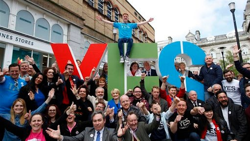 Members of the Yes Equality campaign gather in the center of Dublin, Ireland, Thursday May 21, 2015.  People from across the Republic of Ireland will vote Friday in a referendum on the legalization of gay marriage, a vote that pits the power of the Catholic Church against the secular-minded Irish government of Enda Kenny.  (AP Photo/Peter Morrison)