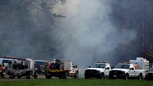 Emergency personnel work where a sightseeing helicopter crashed April 4, 2016, near Sevierville, Tenn. Officials said several people died when the helicopter crashed near the Great Smoky Mountains National Park.