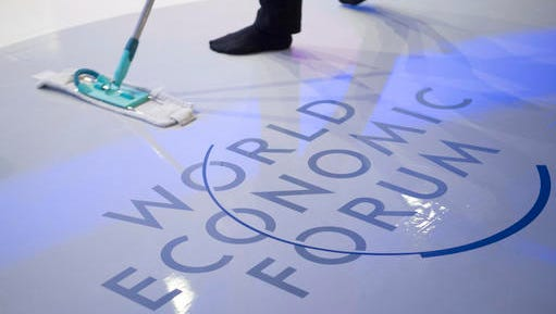 A woman cleans the stage prior to a panel session on the closing day of the 47th annual meeting of the World Economic Forum, WEF, in Davos, Switzerland, Friday, Jan. 20, 2017.
