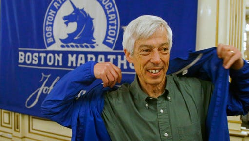 Ben Beach dons a Boston Marathon jacket before a media availability begins at the Copley Plaza Hotel near the Boston Marathon finish line Thursday, April 13, 2017, in Boston. Beach is on the verge of becoming the first person to run the Boston Marathon 50 consecutive times if he completes the race on Monday.