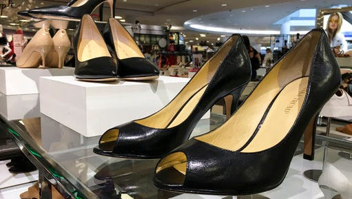 This Monday, March 27, 2017, photo shows Ivanka Trump brand shoes being sold in the Macy's store in Plaza las Americas in San Juan, Puerto Rico. Macy's, Lord & Taylor, and Dillard's all carry her merchandise, which is available online. So does Amazon.com and online shoe company Zappos.com. Perfumania.com carries her fragrances.