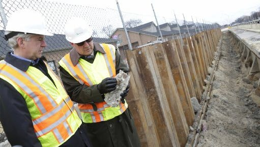 Gov. Rick Snyder, left, is joined at the Lodge Freeway by Michigan Department of Transportation Director Kirk Steudle on Monday,  Dec. 1, 2014, in Detroit as they discuss the amount of work that is needed to help fix Michigan roads.