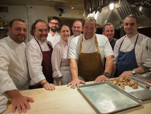 Cincinnati chefs David Falk, Jean-Robert de Cavel, Stephen Williams, Julie Francis, Jean-Philippe Solnom, David Cook, Jeremy Lieb and Jose Salazar pose for a picture inside the kitchen at the James Beard House in New York on May 10, 2014. The Cincinnati chefs were invited to cook dinner at the home of the James Beard Foundation, which promotes fine American cooking, as an extension of the Cincy in NYC campaign.