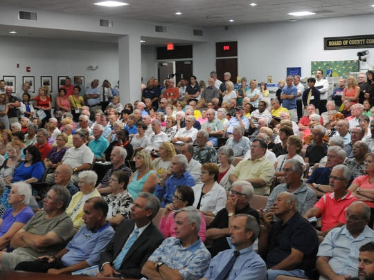 Hundreds of people packed the Brevard County Commission